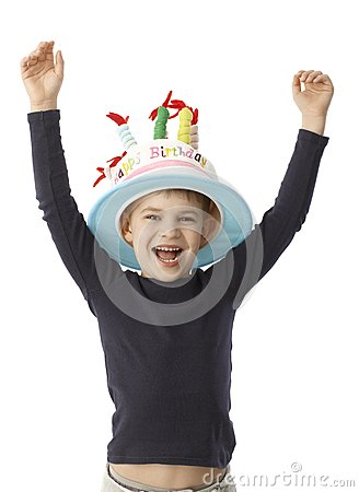 Birthday boy smiling happy in funny hat