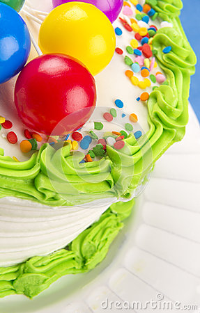 ... birthday cake green icing trim and multi-color sprinkles and colored