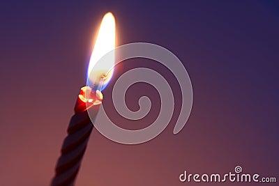 Birthday candle lit