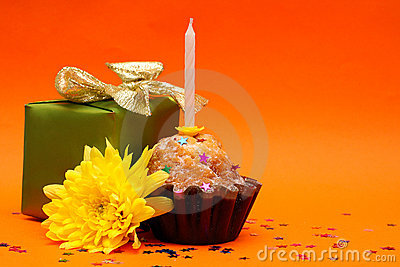 Birthday cupcake, gift and flower