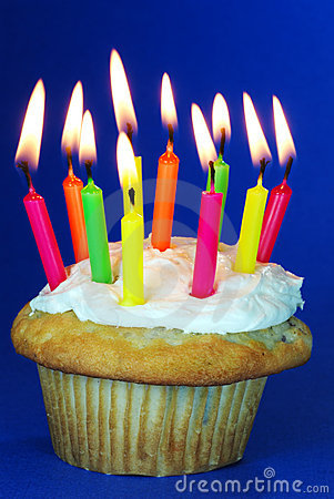 Birthday cupcake with lots of candles