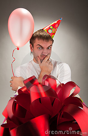 Birthday man looking big gift box