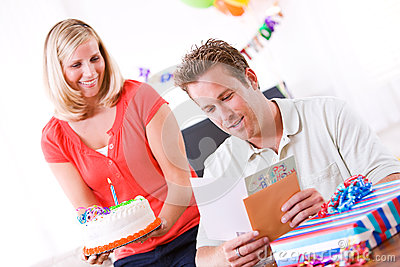 Birthday: Man Reads Card Before Getting Cake
