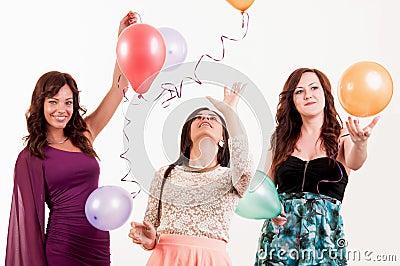 Birthday party celebration - three woman with ballons having fun