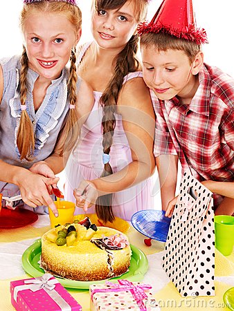Birthday party group of child with cake.