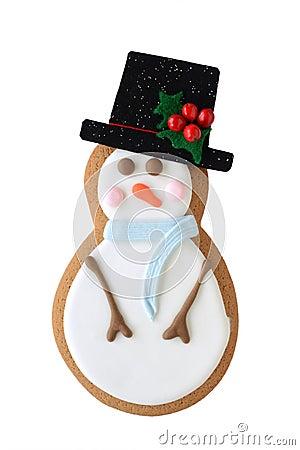 Biscotto del pupazzo di neve isolato su bianco