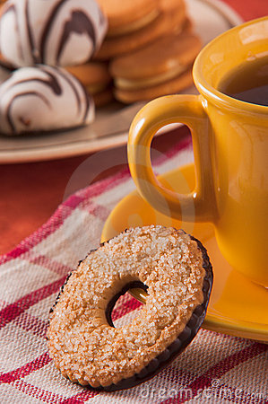 Biscuit with cup of tea and decoration
