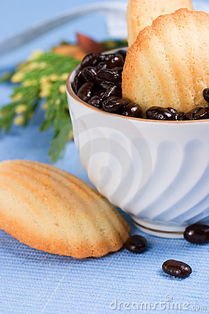 Biscuits and coffee beans on blue napkin
