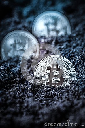 Free Bitcoin In Earth - Cryptocurrency Mining Concept Stock Photo - 136137080