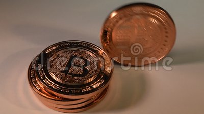 Bitcoin Copper Rounds Standing then Toppling Down, Finance Illustration. Stack of bitcoin copper rounds, one of them standing and toppling down on white stock video