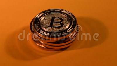 Technology E-Commerce Online Payments Cryptocurrency Bitcoin - Slow Panning Move, Orange Background. Stack of bitcoins visualizing Crypto currency online stock video footage