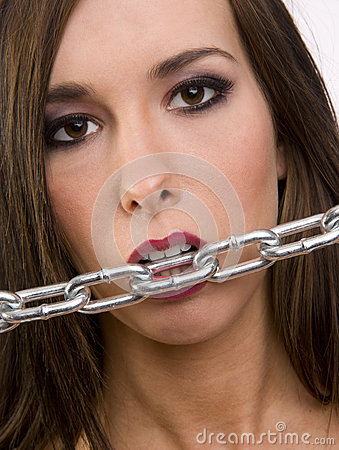Beautiful Brunette Woman Appears to Bite the Chain