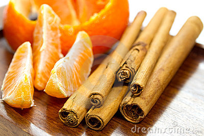 Bits of orange and cinnamon sticks
