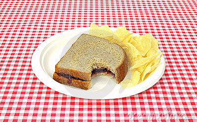 Bitten grape jelly sandwich on wheat