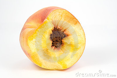 Bitten juicy peach on white