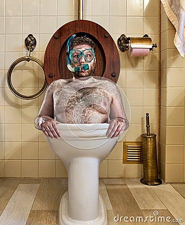 Free Bizarre Man In Vintage Toilet Royalty Free Stock Photos - 24673258