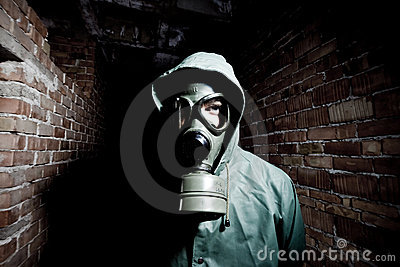 Bizarre portrait of man in gas mask