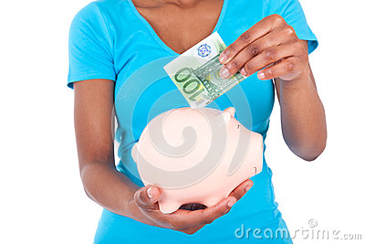 Black african american woman inserting a euro bill inside a smil