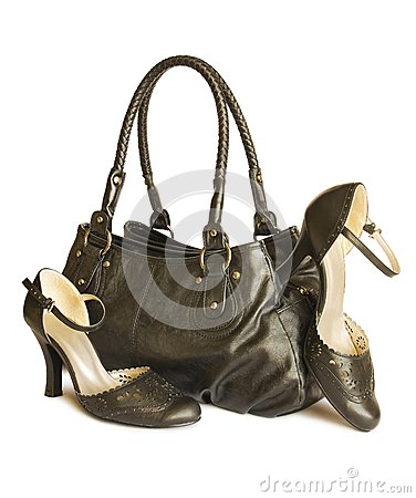 Black bag with shoes isolated on white