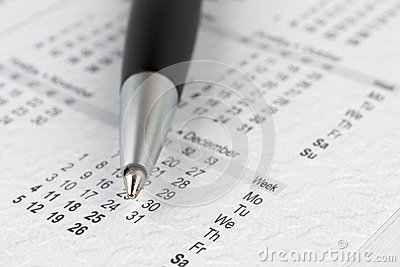 Black ballpoint pen on a calendar