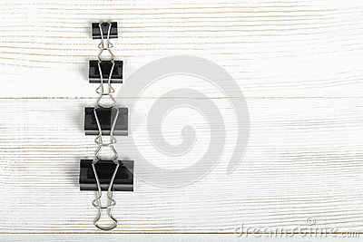 Black Binder Clips Posted From The Biggest To Smallest On A Wooden ...