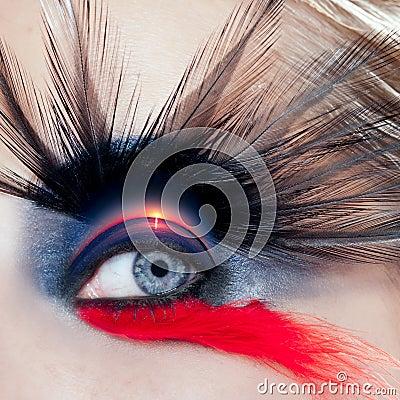 Black bird woman eye makeup macro beach sunrise