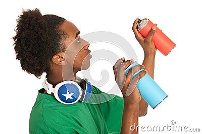 Black boy spraying graffiti