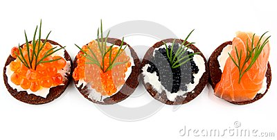 Black bread topped with salmon, trout and sturgeon caviar