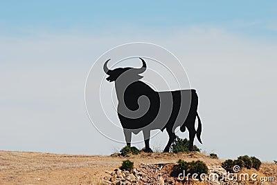 Black bull in spanish landscape