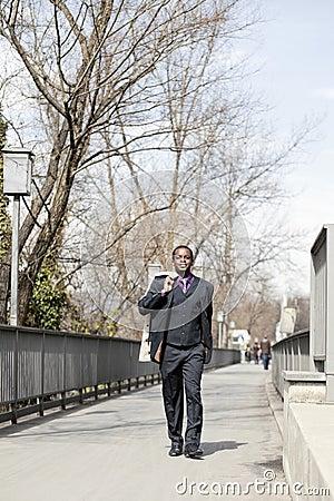 Black business man walking on street