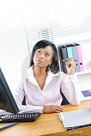 Black businesswoman working at desk