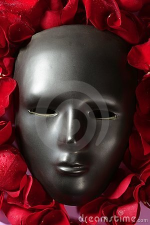 Black carnival mask with red rose petals