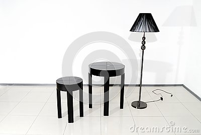 Black chair, table and floor lamp