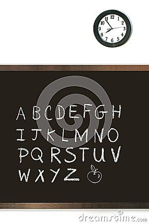 Black chalkboard with clock