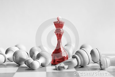 Black chess queen beats whites on chessboard Stock Photo