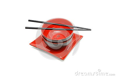 Black chopsticks on two Japanese bowls and square