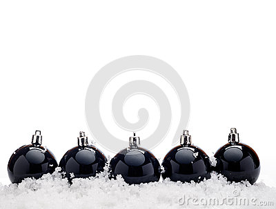 Black christmas balls with snow