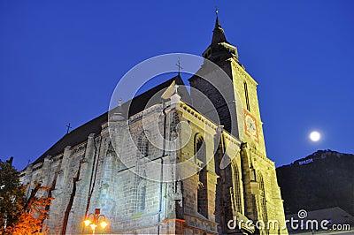 Black church at night, Transylvania, full moon