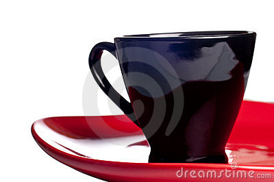 Black coffee cup on a red plate