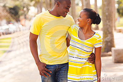 Black couple walking street
