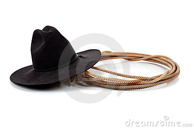 Black cowboy hat and lasso on white