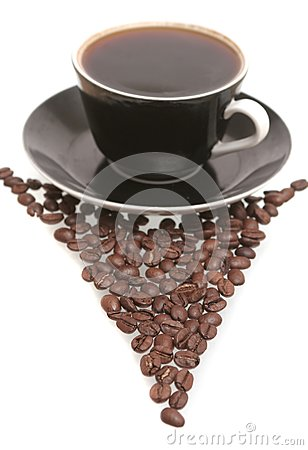 The black cup with fragrant coffee costs on a tabl