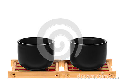 Black cups on a stand