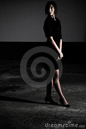 Black Dress Standing In Shadow