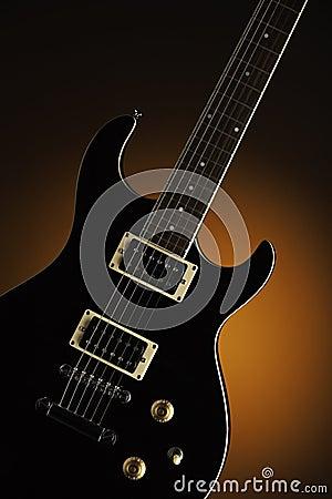 Black Electric Guitar on Orange
