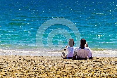 Black family and azure sea