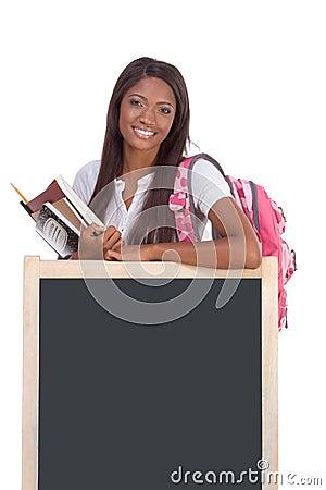 Black female College student by blackboard