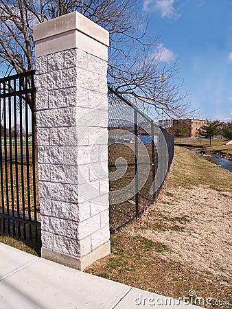 Black fence and cornerstone