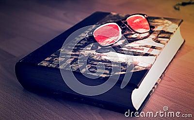Black Framed Sunglasses On Black Book Free Public Domain Cc0 Image