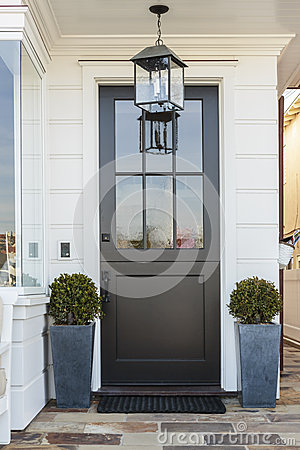 Black Front Door Framed By Plants Stock Photo Image